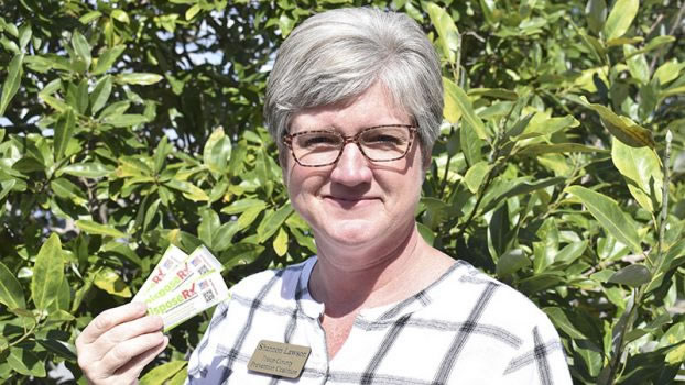 Parent Engagement: Troup County Prevention Coalition project coordinator Shannon Lawson poses for a photo with DisposeRX packets. Credit Gabrielle Jansen | LaGrange Daily News
